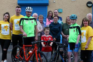 Strabane's Shane Kelly receives hero's welcome after epic cycle in memory of mum